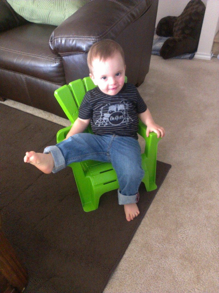 Trying to sit like Mommy. I guess I need to sit properly more often!