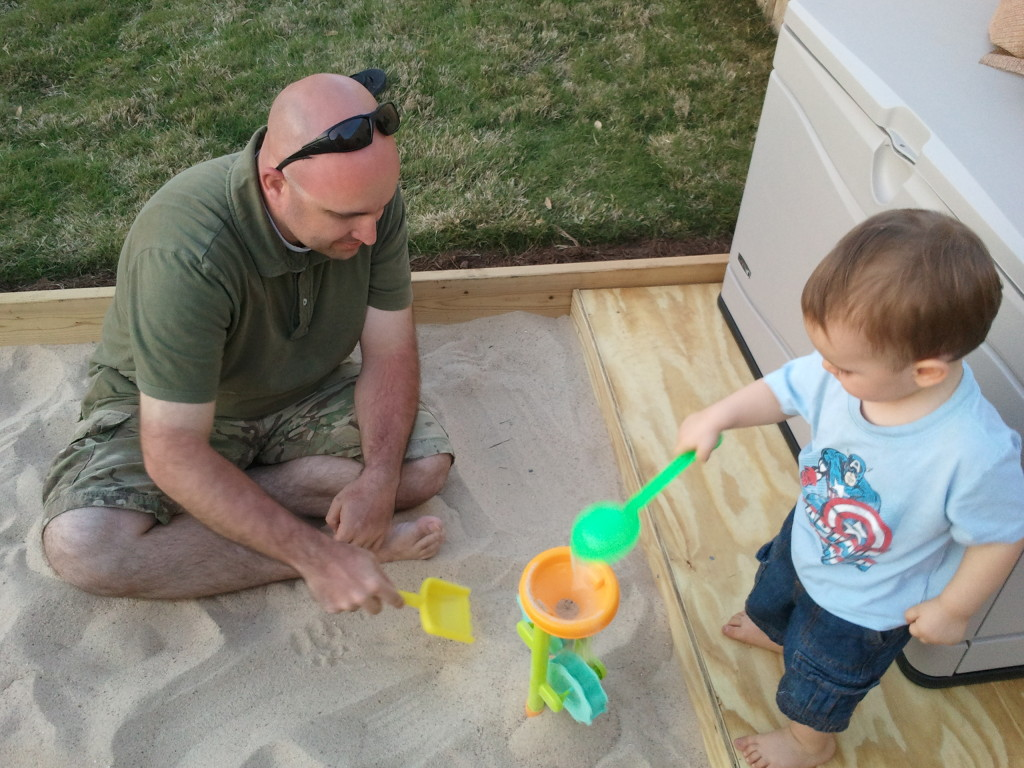 Daddy and Joseph breaking in the new play area.