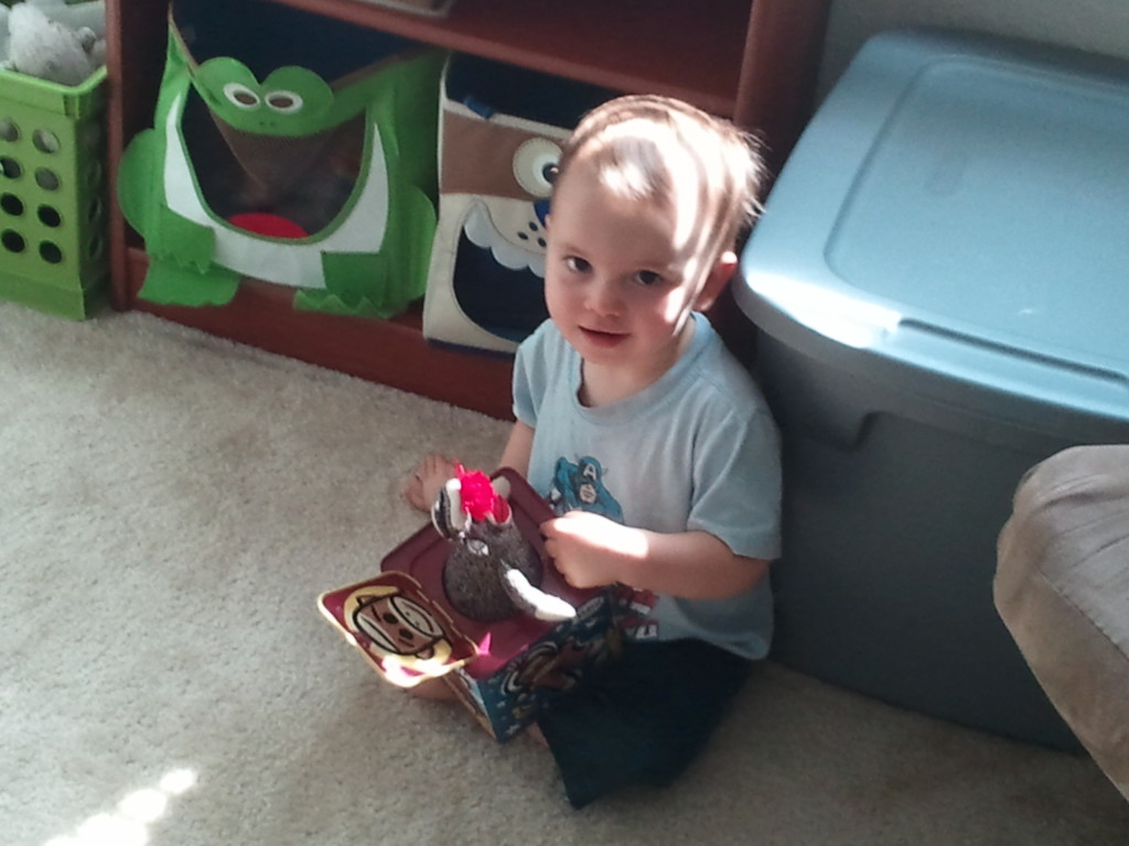 Playing with his monkey jack-in-the-box