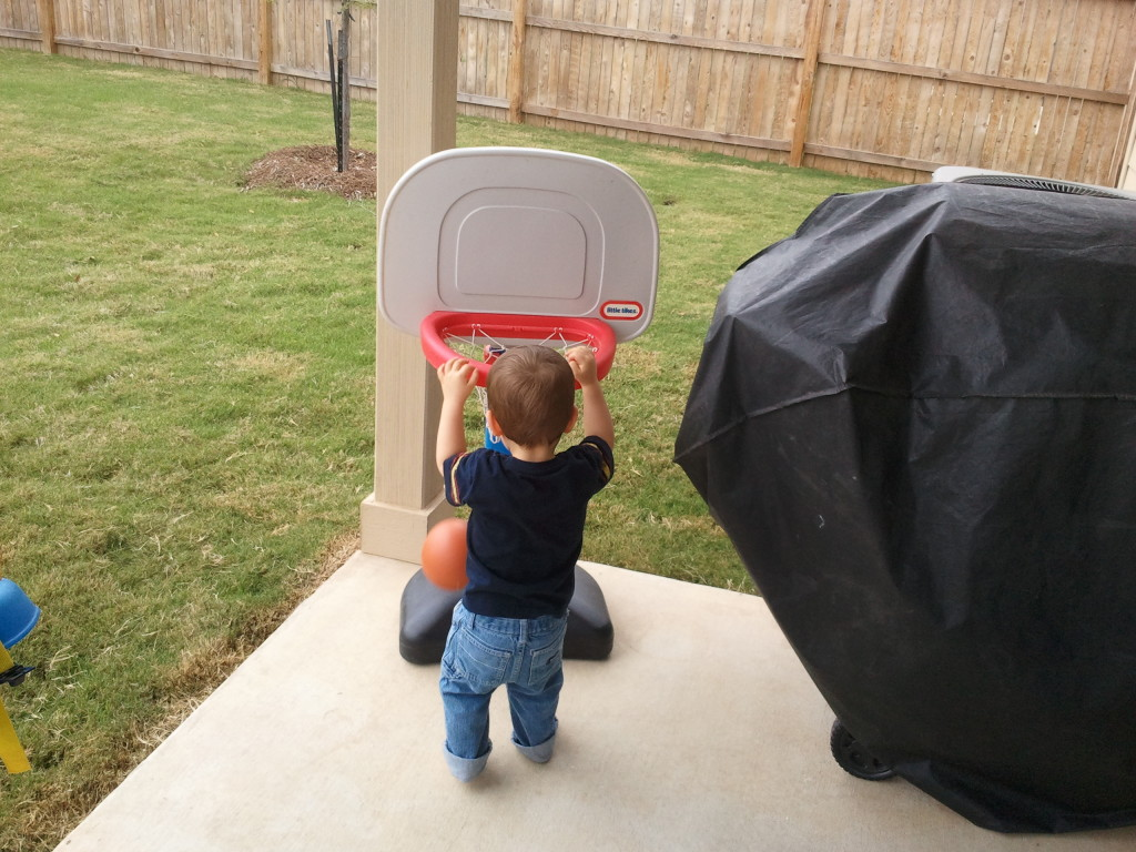 Dunking the basketball.