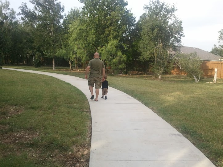 Walking with Daddy at the park