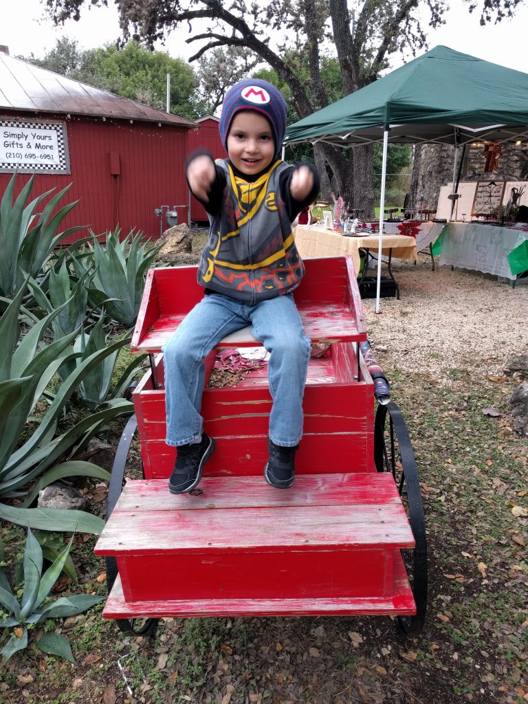 """Driving"" the wagon in Old Town Helotes while at the craft fair with Paul."