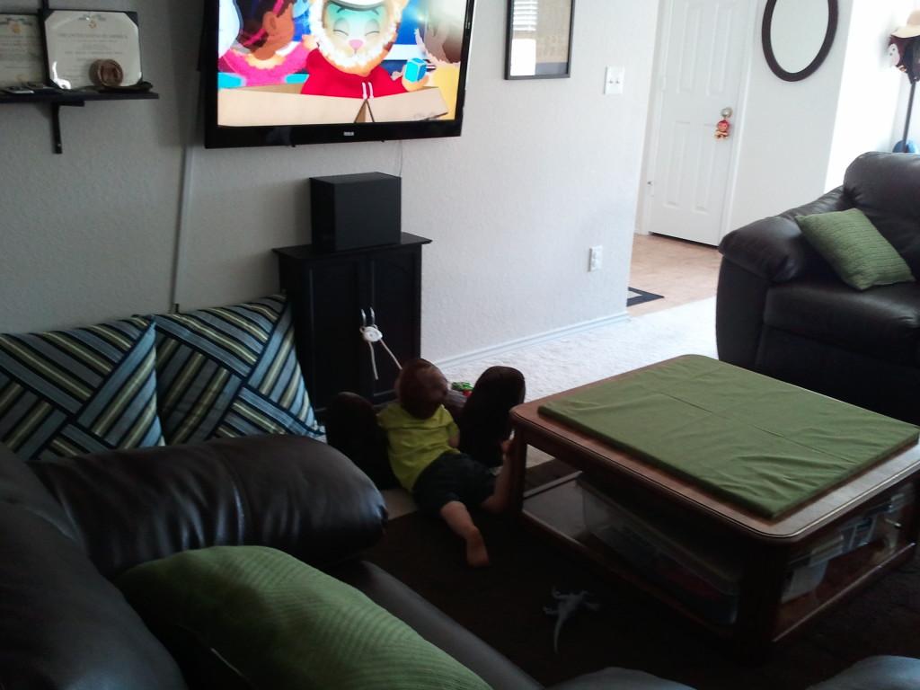 Lounging around while watching TV.