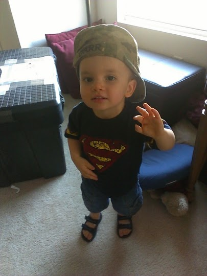 Loves wearing Daddy's hats.