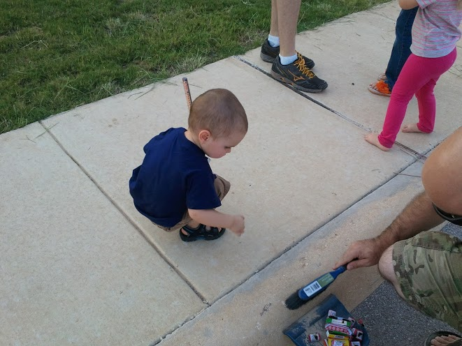 Helping Daddy clean up the used fireworks