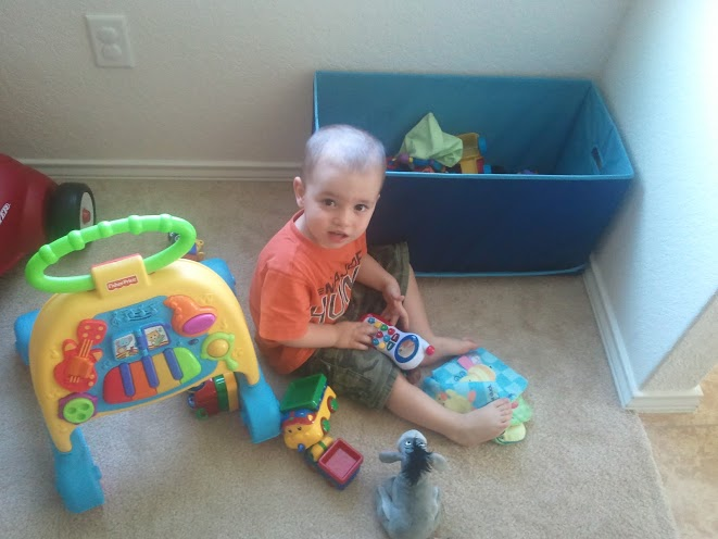 Playing with his toys