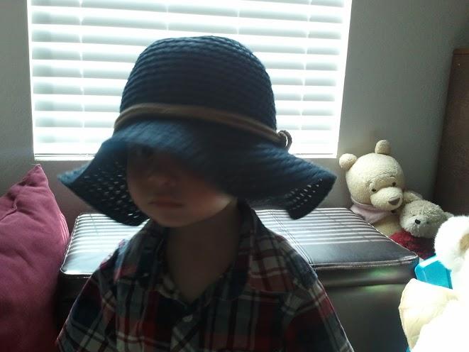 If he can get a hold of anyone's hat, it's on his head