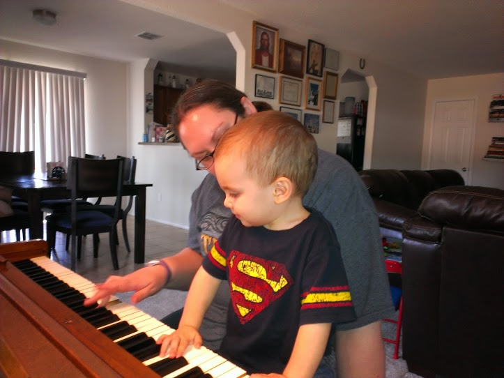 He loves playing piano with me